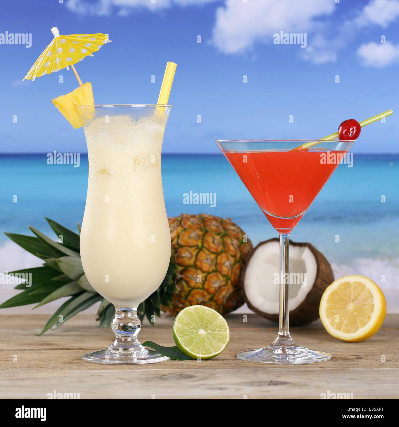 Cocktails and alcohol drinks like Pina Colada and Martini on the beach - Stock Image