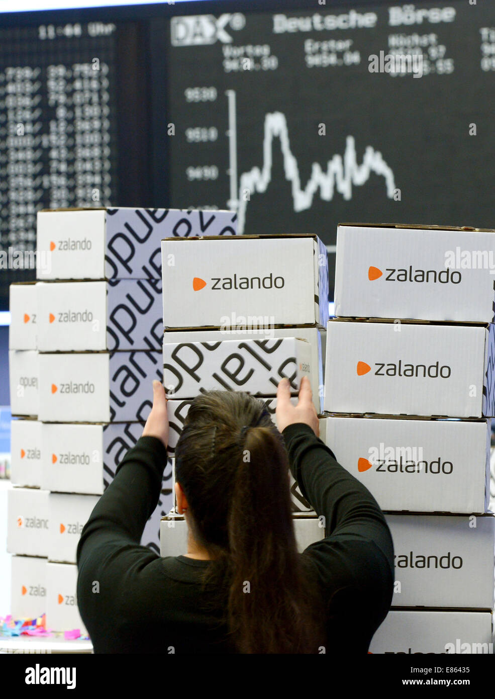 Zalando boxes stand in front of the DAX display panel at the Frankfurt stock exchange during the stock market launch Stock Photo