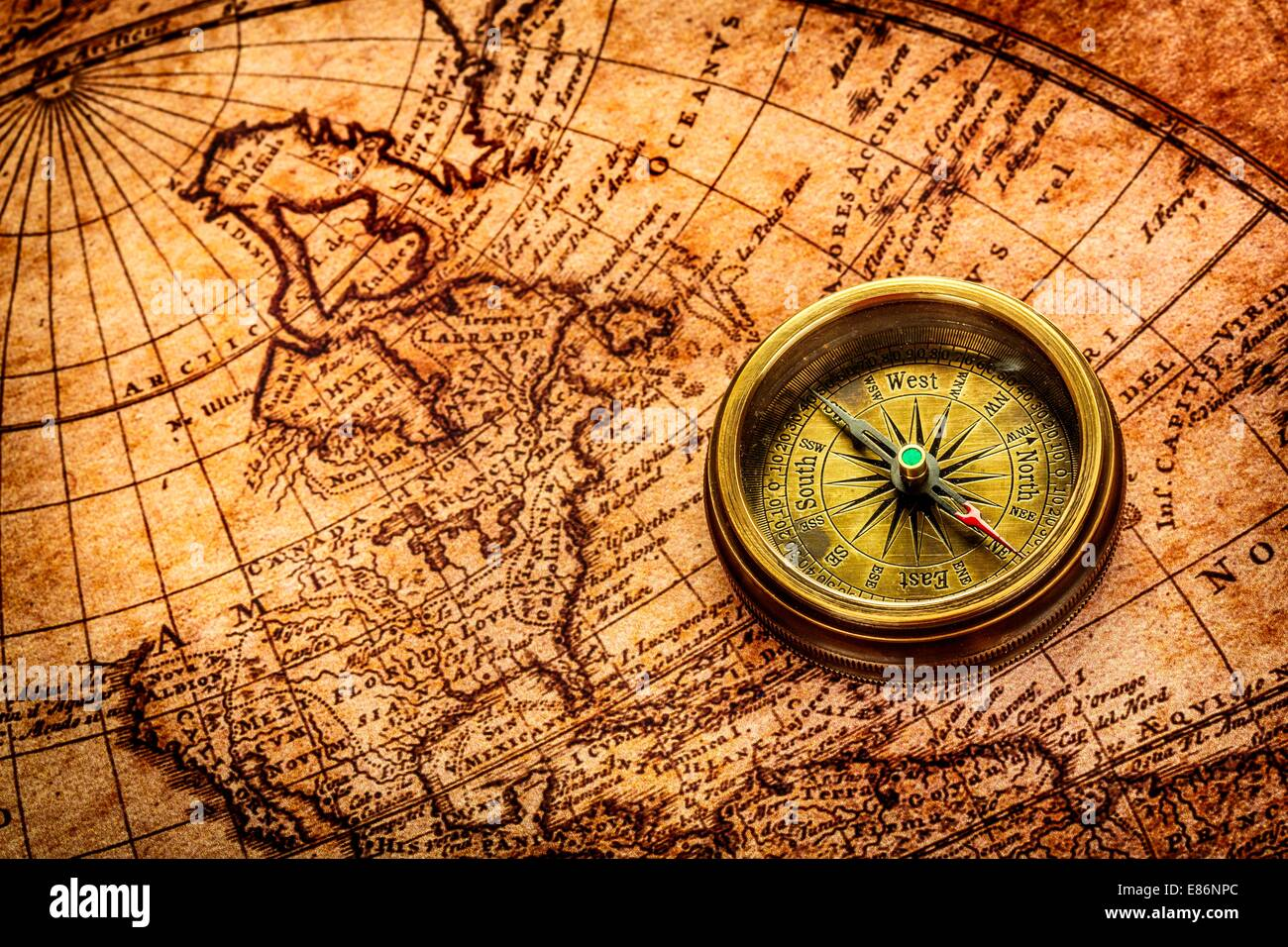Vintage still life vintage compass lies on an ancient world map vintage compass lies on an ancient world map gumiabroncs Image collections