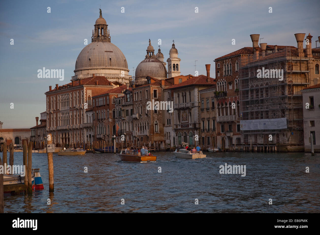 Venice and its, grand canal basks, in the warmth,of the late afternoon sun, While water taxis,ply their trade on - Stock Image
