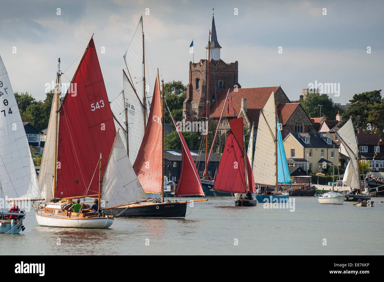 Various sailing craft participate in the spectacular Parade of Sail at the Maldon Regatta in Essex. - Stock Image