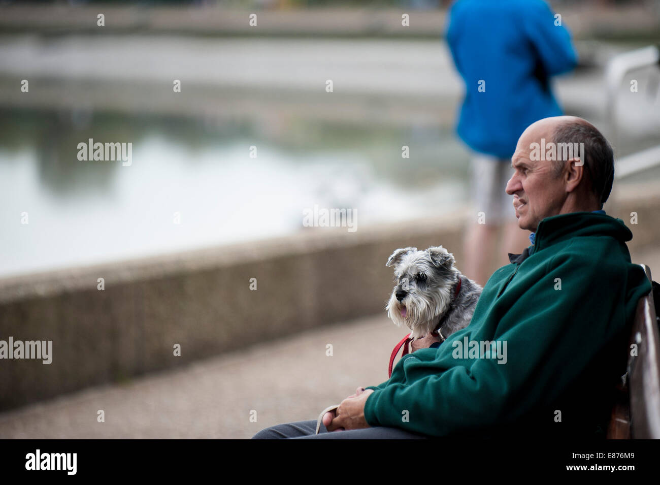 People and their pet dog. - Stock Image