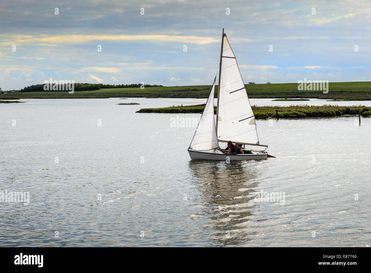 A small sailboat dinghy on the Blackwater River in Essex. - Stock Image