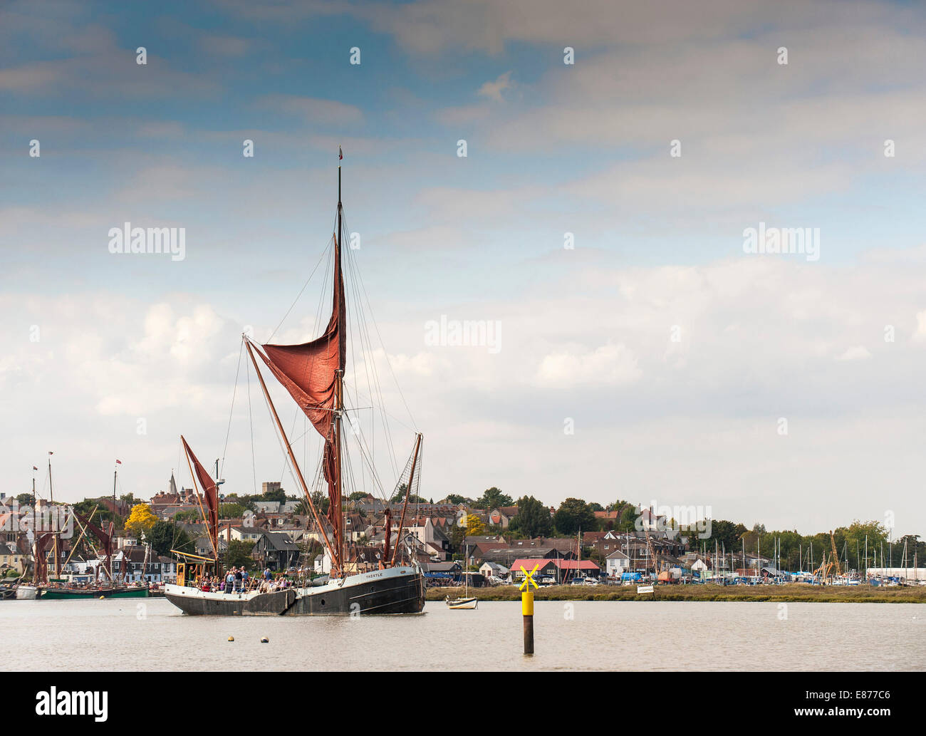 The Sailing Barge 'Thistle' leaving Maldon and sailing downriver on the Blackwater River in Essex. - Stock Image