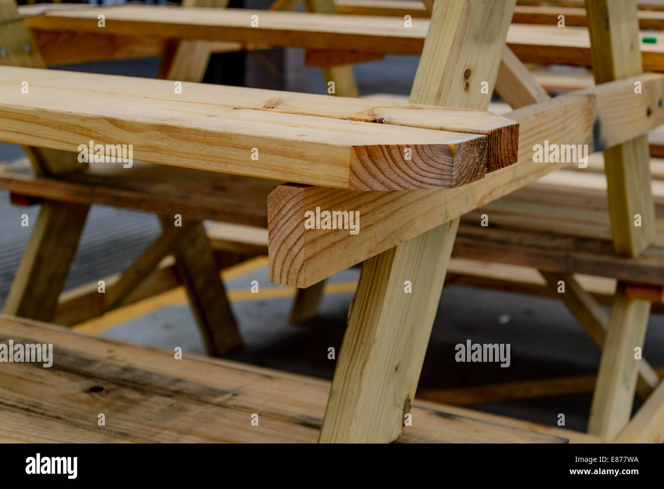 Building Supplies Stacked Wood Picnic Tables Stock Photo - Picnic table supplies