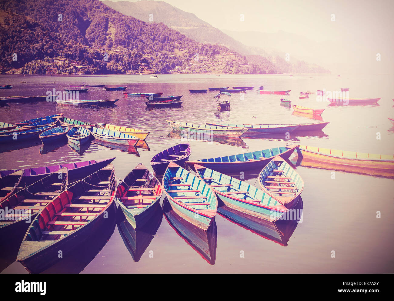 Vintage picture of small boats on lake with retro filter. - Stock Image