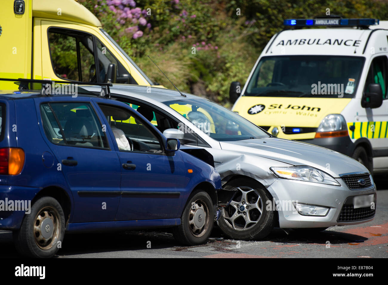 Two cars involved in a side impact road traffic accident collision ...