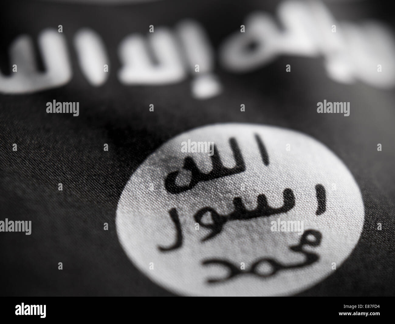 Abstract macro view of ISIS flag with shallow depth of field. Stock Photo