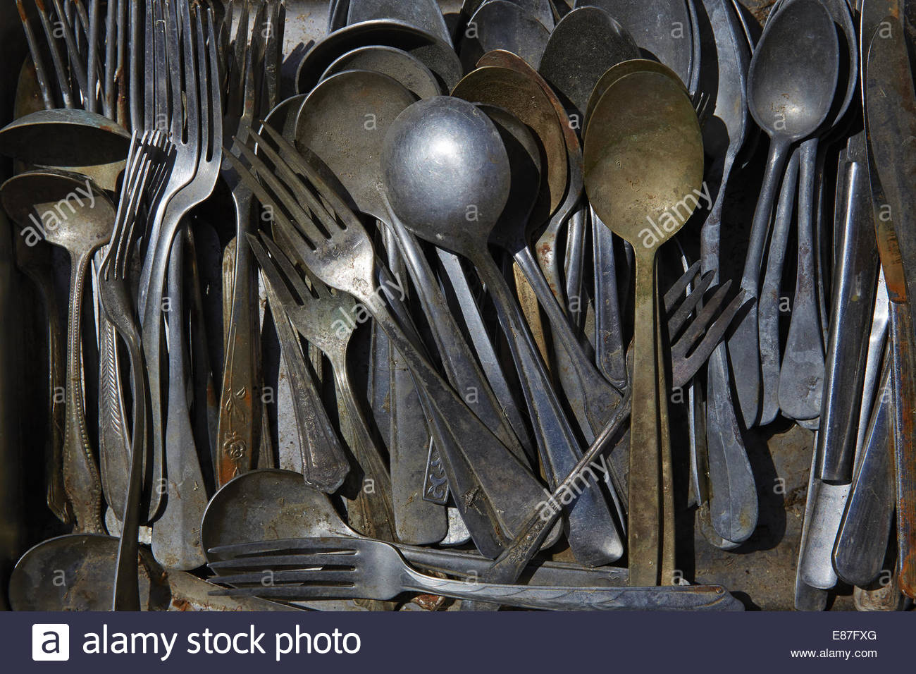 Vintage and rusty group of utensils & silverware. - Stock Image