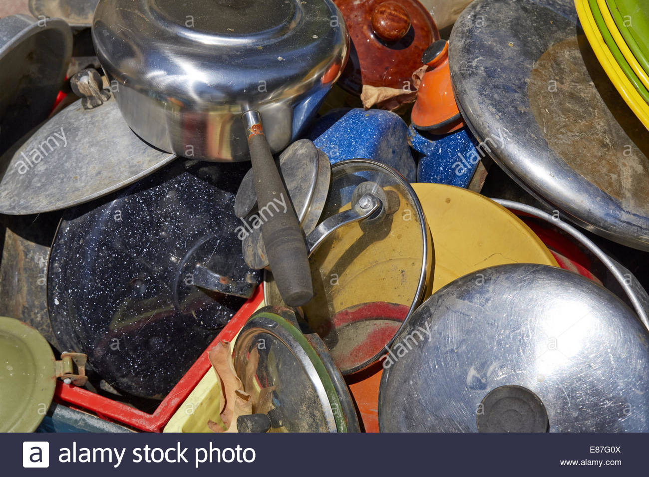 Dusty, Rusty, discarded pots and pans, plates, dishes and house wares - Stock Image