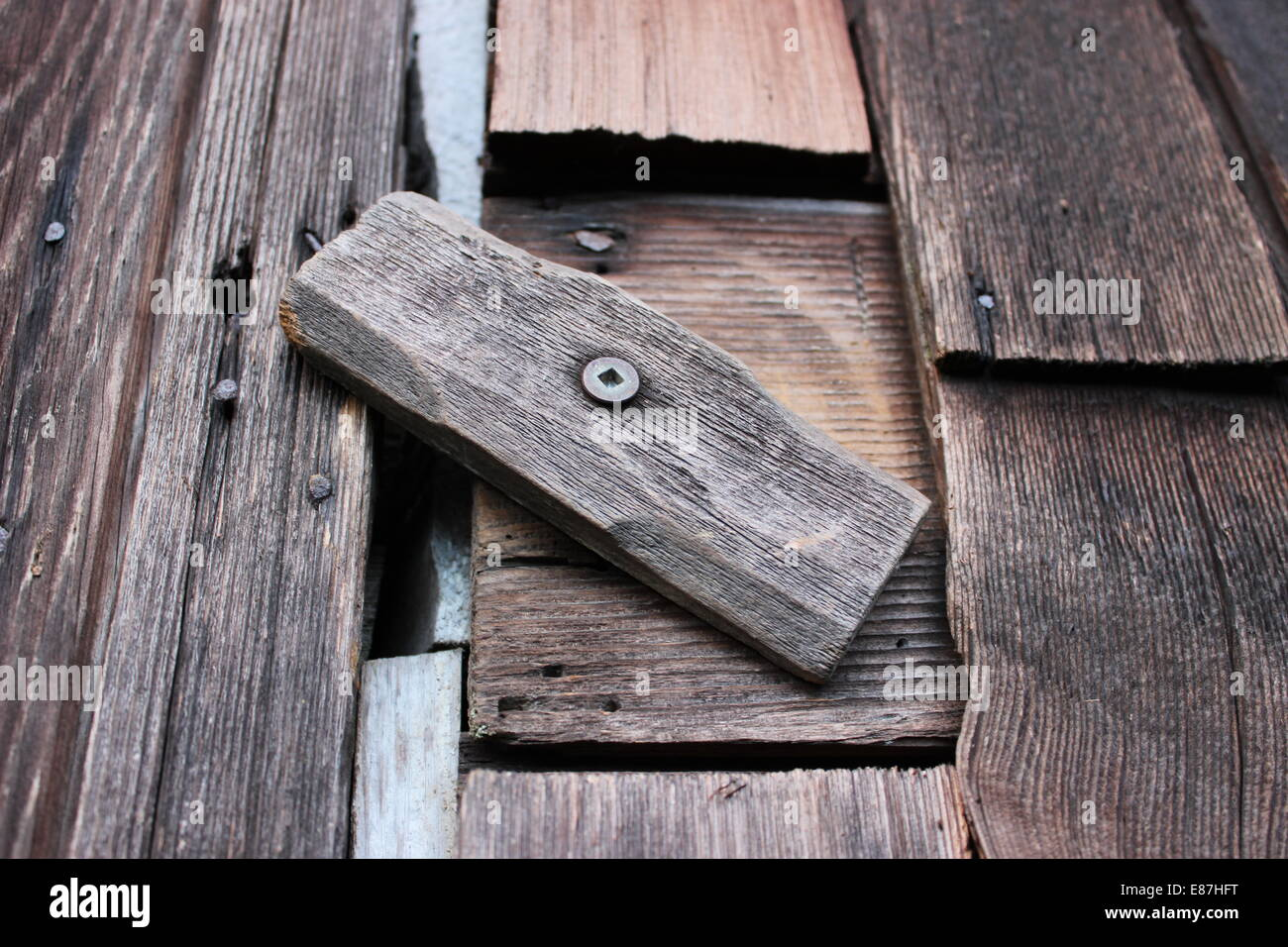 An old wooden barn latch - Stock Image