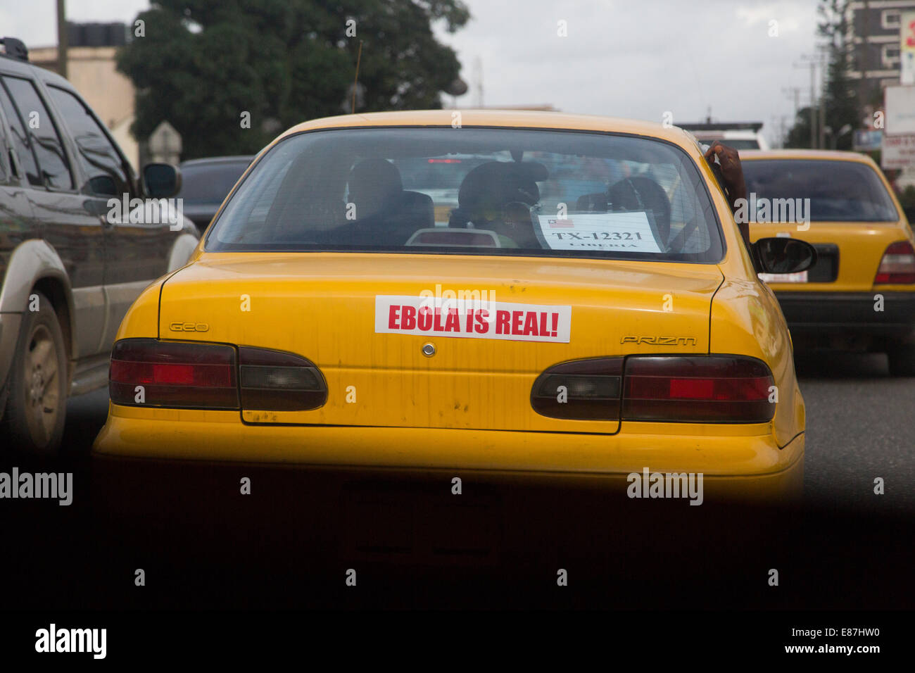 A taxi in Monrovia Liberia has a bumper sitcker that reads, Ebola Is Real!. 2014-09-01 12:37:41 - Stock Image