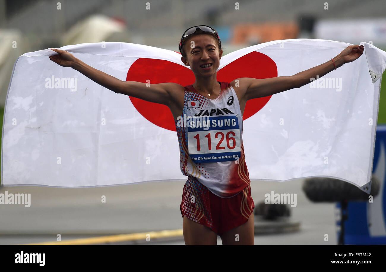 Incheon, South Korea. 2nd Oct, 2014. Kizaki Ryoko of Japan celebrates after the women's marathon of athletics - Stock Image