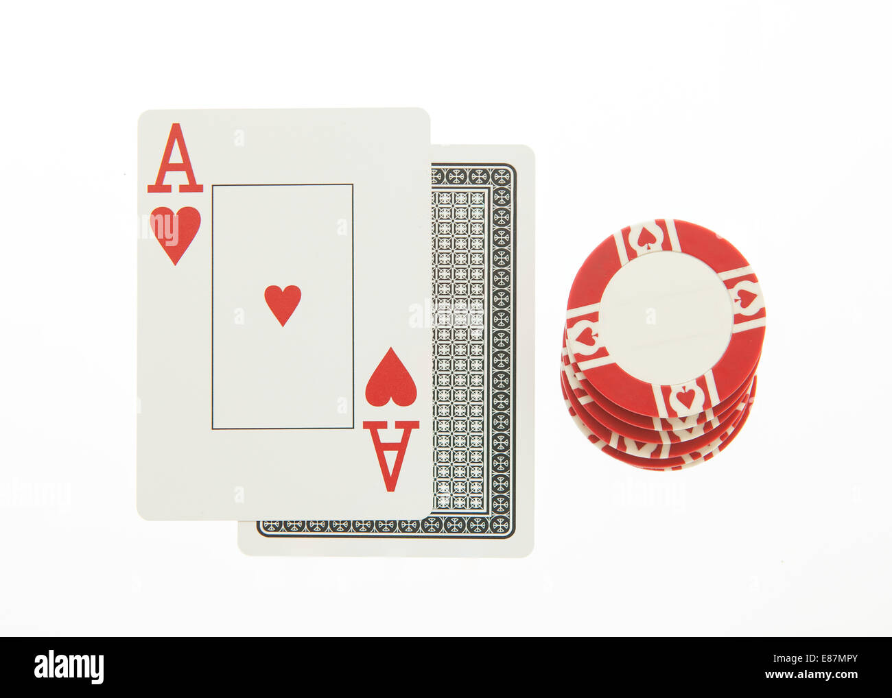 Blackjack hand with casino chip - Stock Image