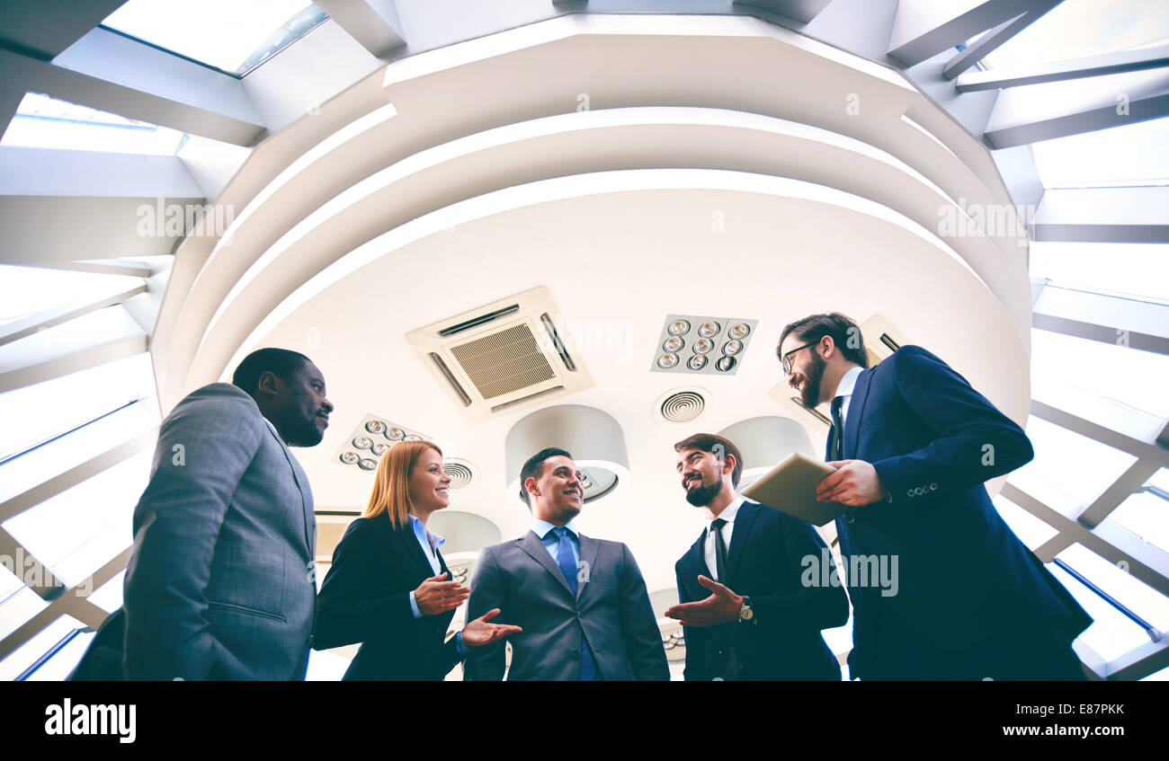 Group of competitive business people discussing ideas or plans - Stock Image
