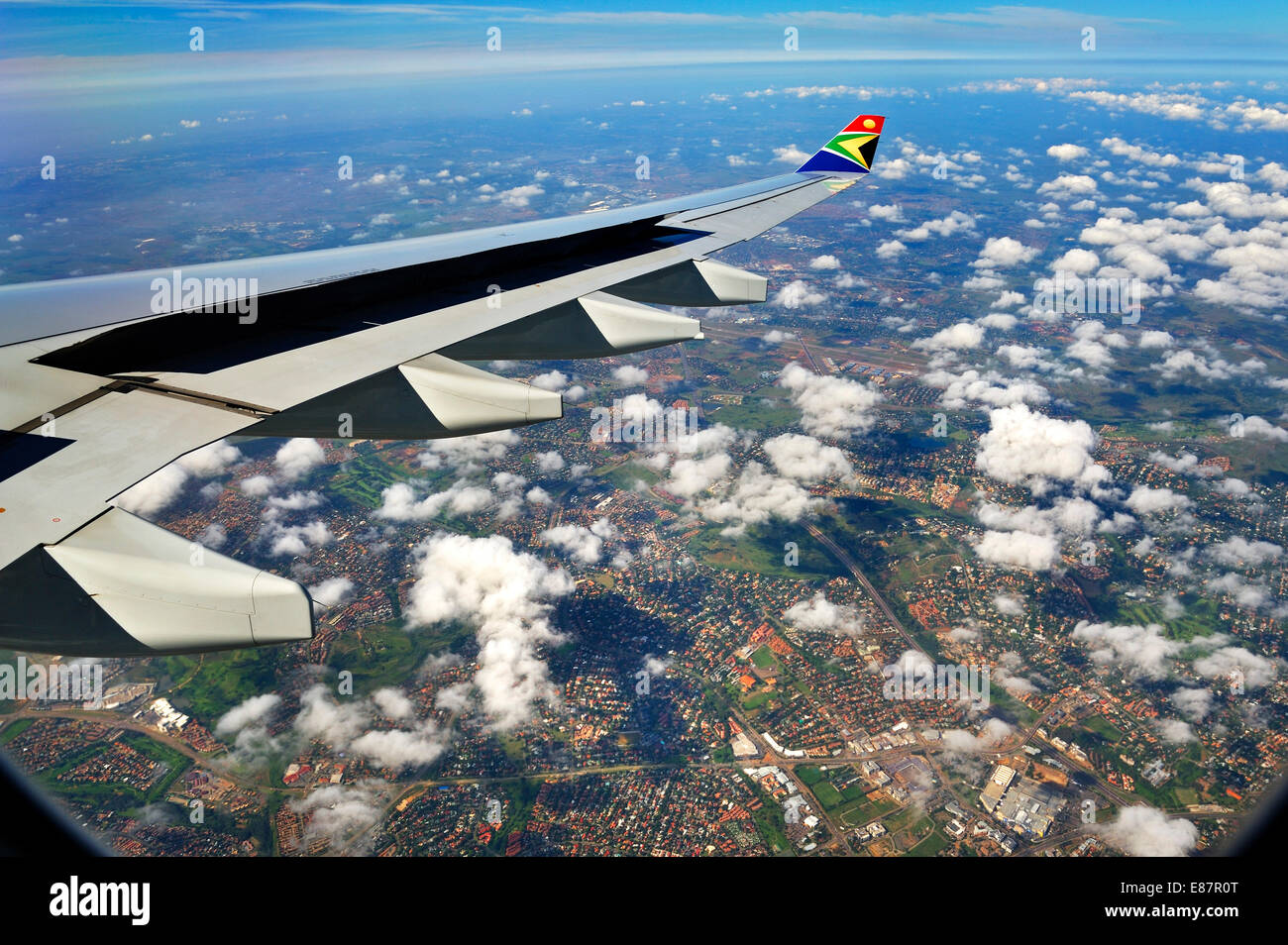 Wing of an Airbus in flight, with winglet and the logo of SAA, South African Airways, suburbs of Johannesburg at - Stock Image