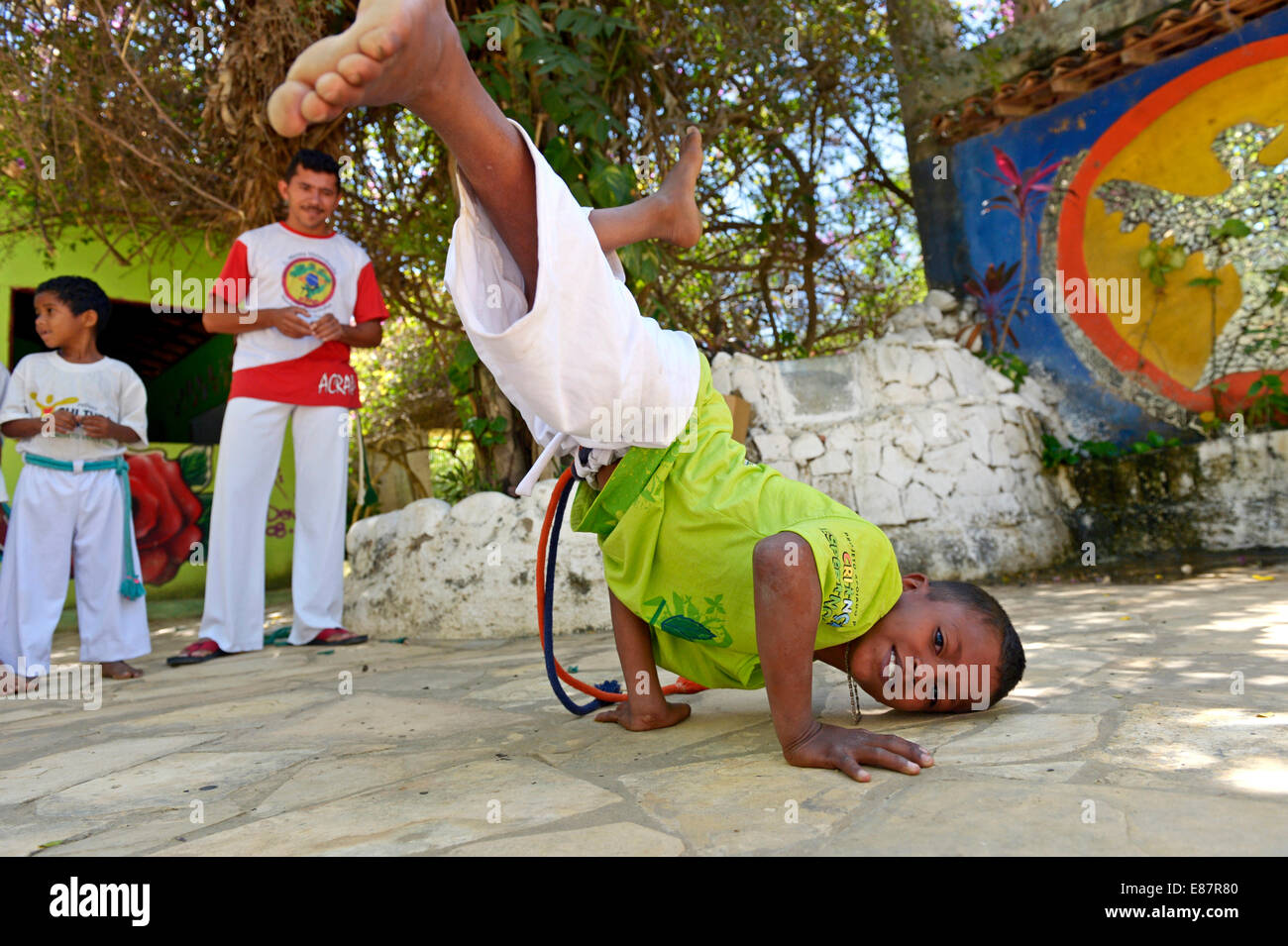 Boy performing acrobatics, Capoeira lessons, Crato, State of Ceará, Brazil - Stock Image