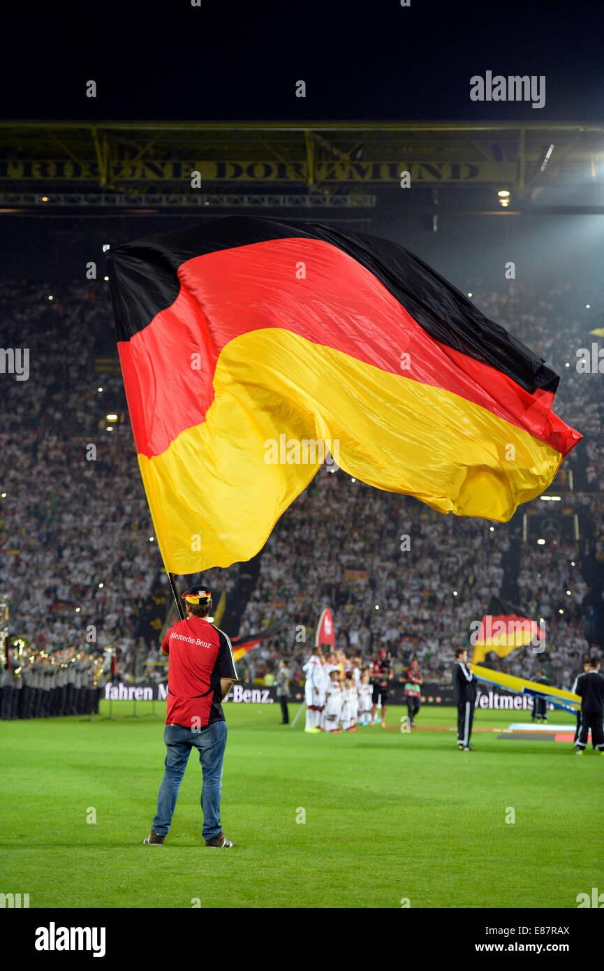 Atmospheric choreography with flag-wavers, Signal Iduna Park, North Rhine-Westphalia, Germany - Stock Image