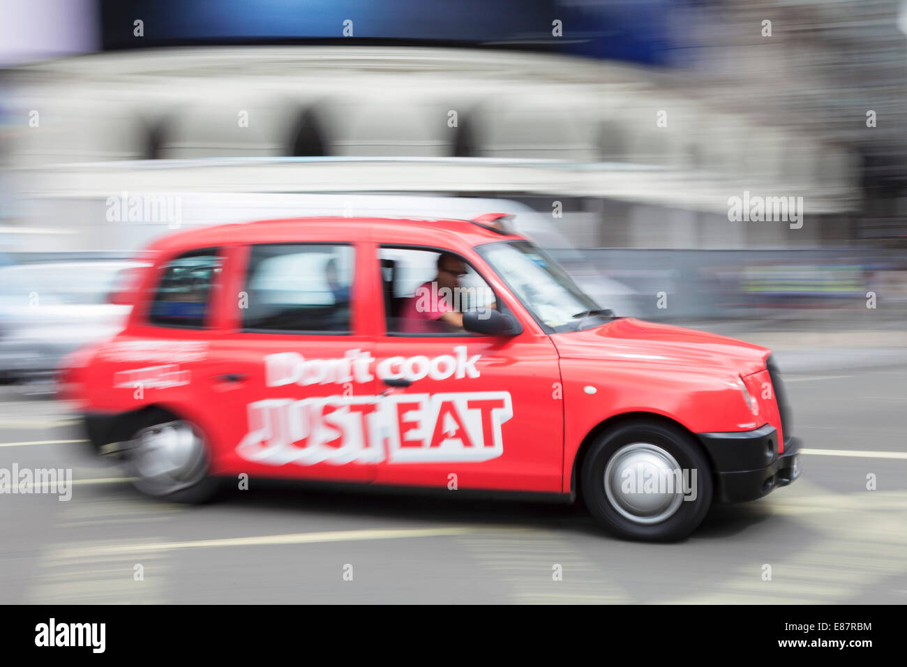 Taxi, motion blur, Piccadilly Circus, London, England, United Kingdom - Stock Image