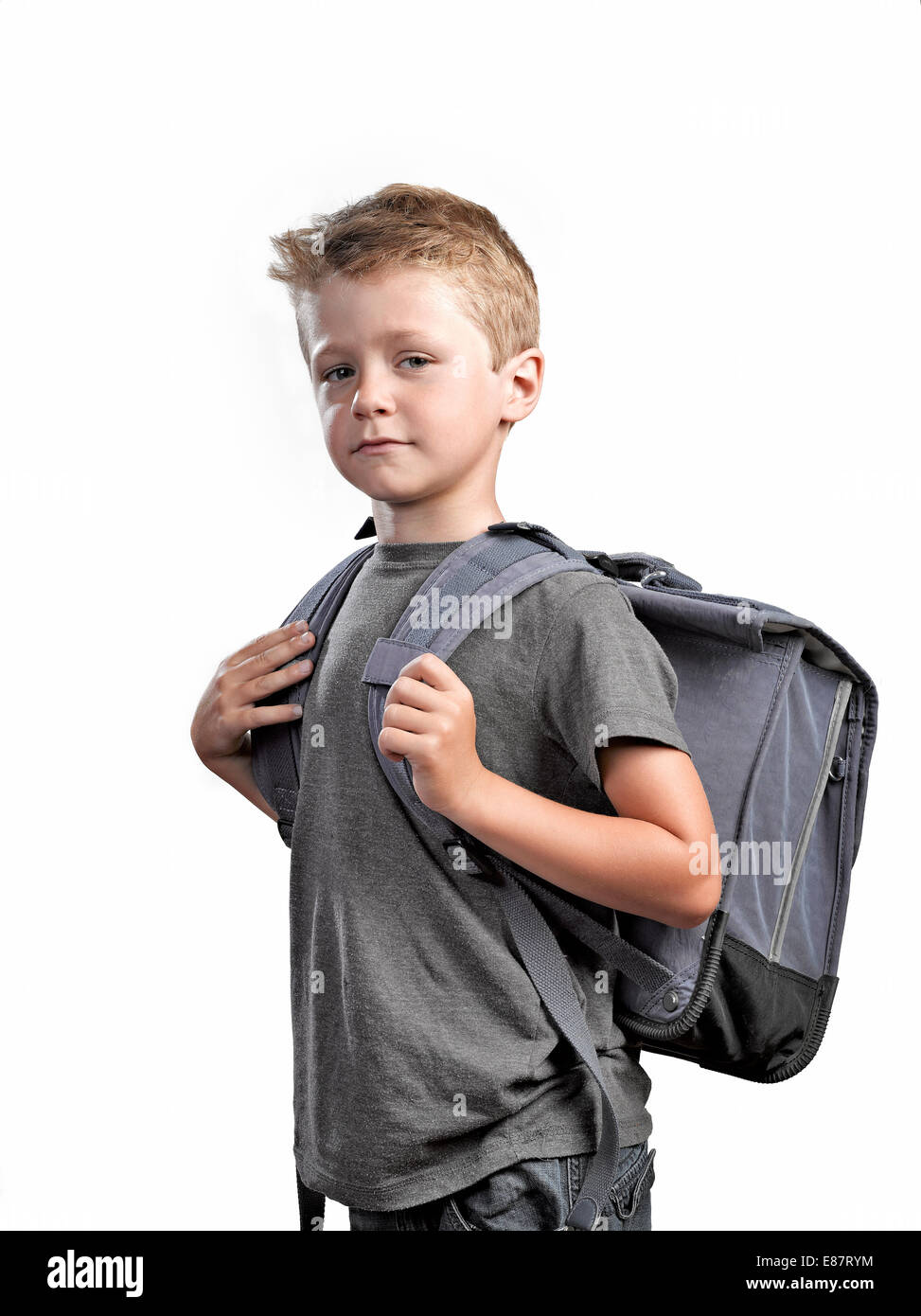 0db3d9fe0529 Young boy with backpack isolated on white background ready to go ...