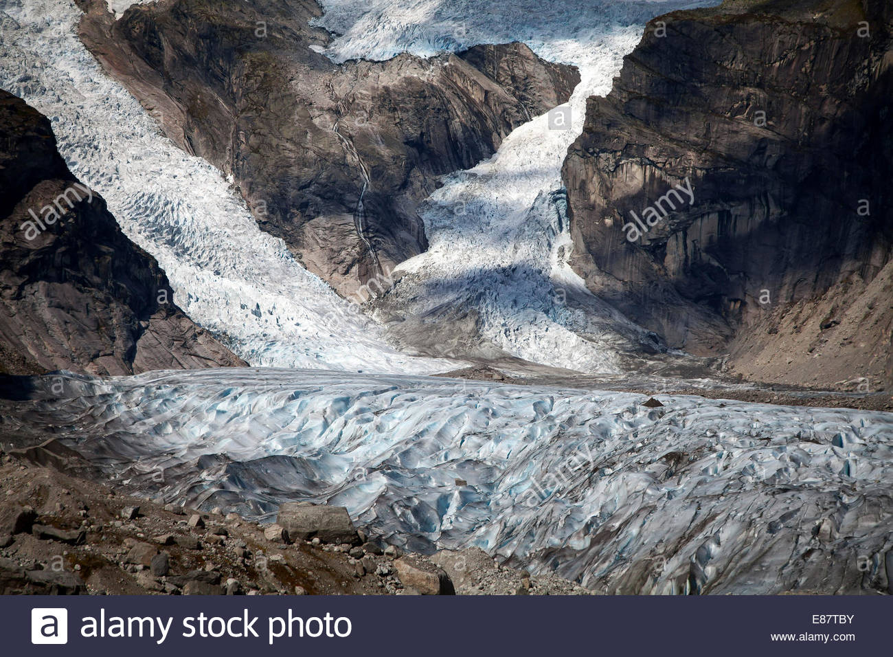 Two glacier tongues of the Austerdalsbreen, tongues of the Jostedalsbreen unite in the valley, glacier ice - Stock Image