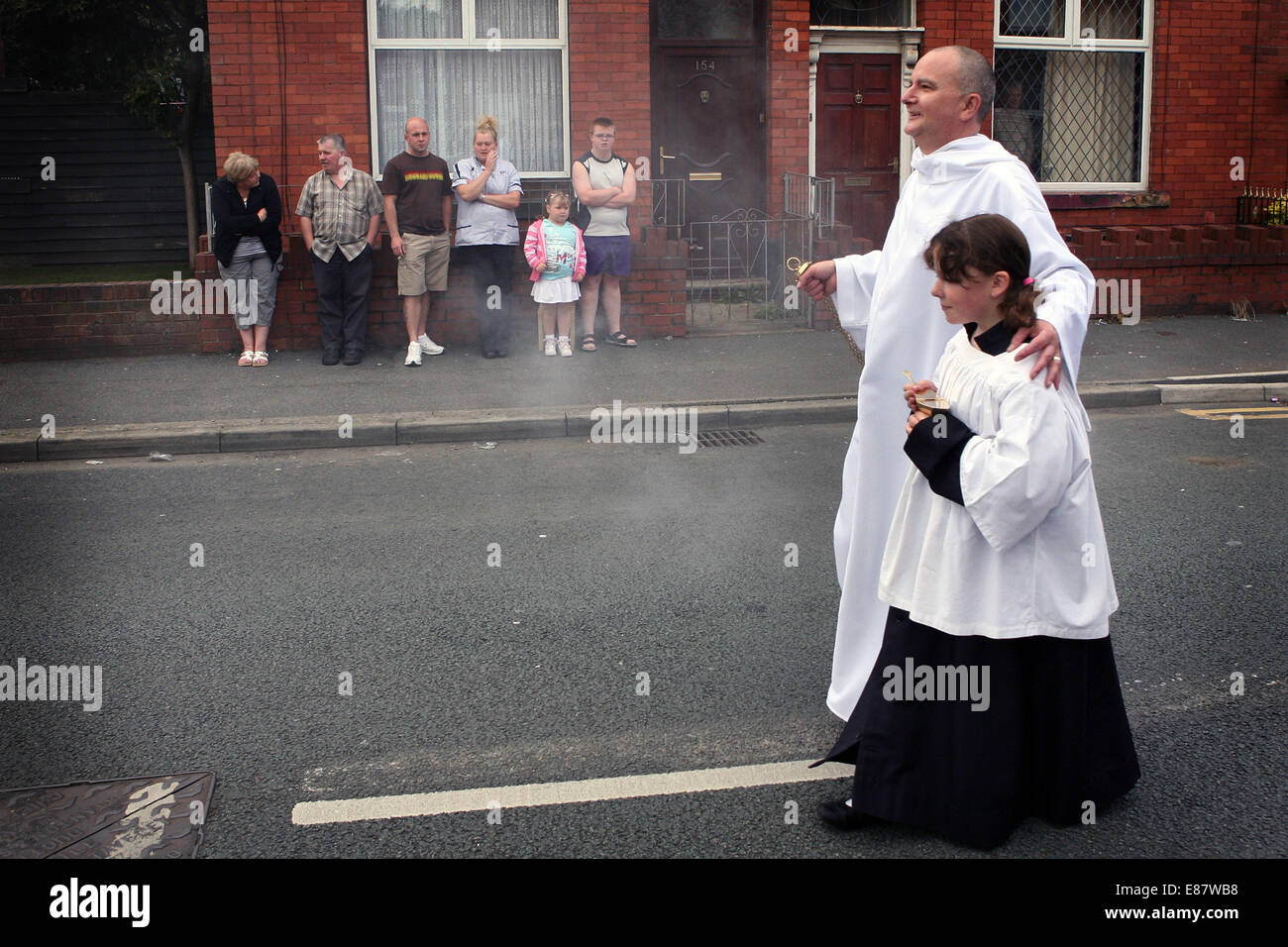 The procession from St Margaret's Church to the Hollinwood and Limeside festival. Picture: Chris Bull - Stock Image