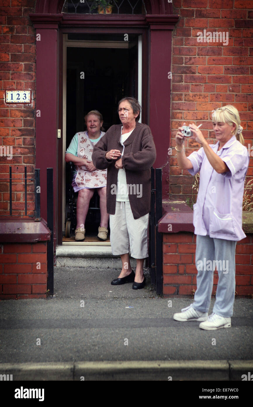 The procession from St Margaret's Church to the Hollinwood and Limeside festival.  Local residents watch the - Stock Image