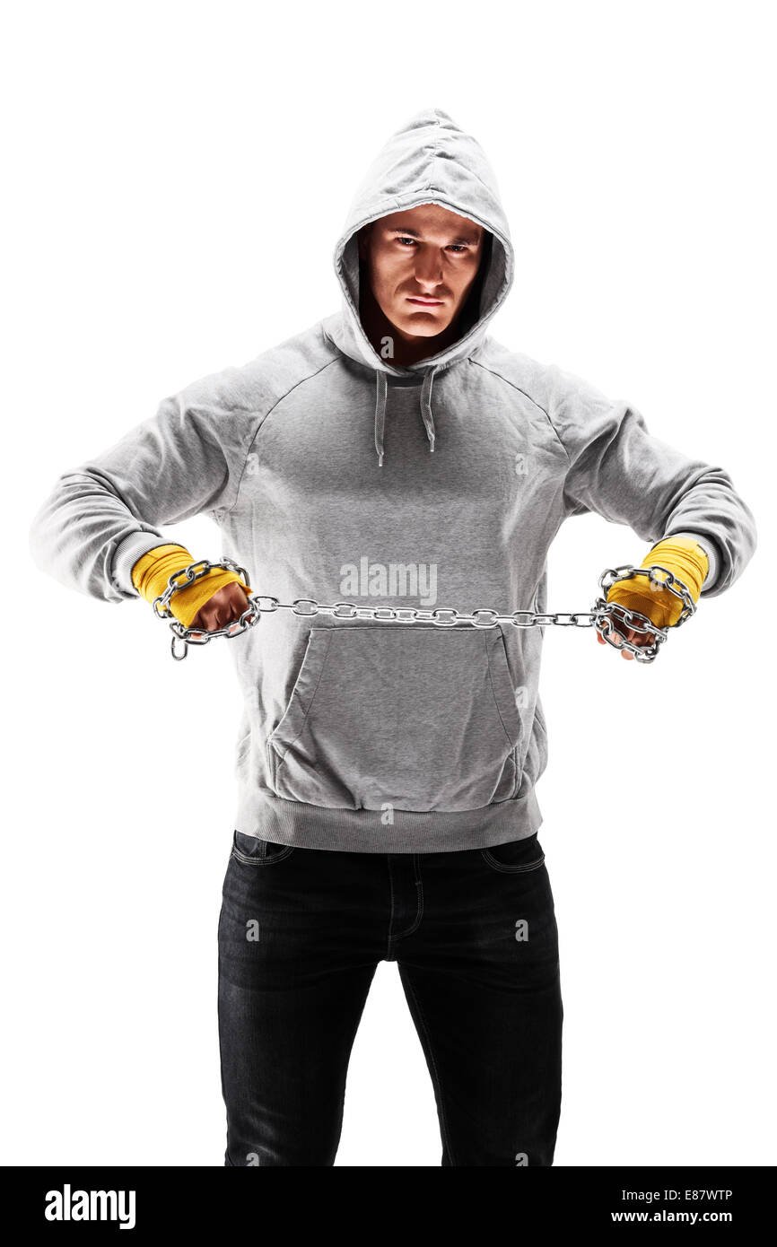 Vertical shot of a hooligan holding a chain - Stock Image