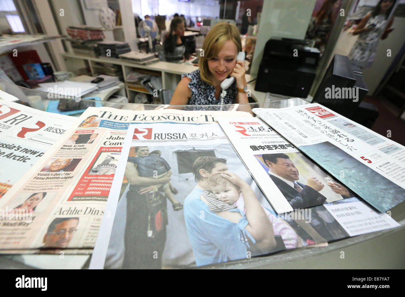 MOSCOW, RUSSIA. OCTOBER 2, 2014. A girl sitting at the reception desk at the offices of the 'Russia Beyond the - Stock Image