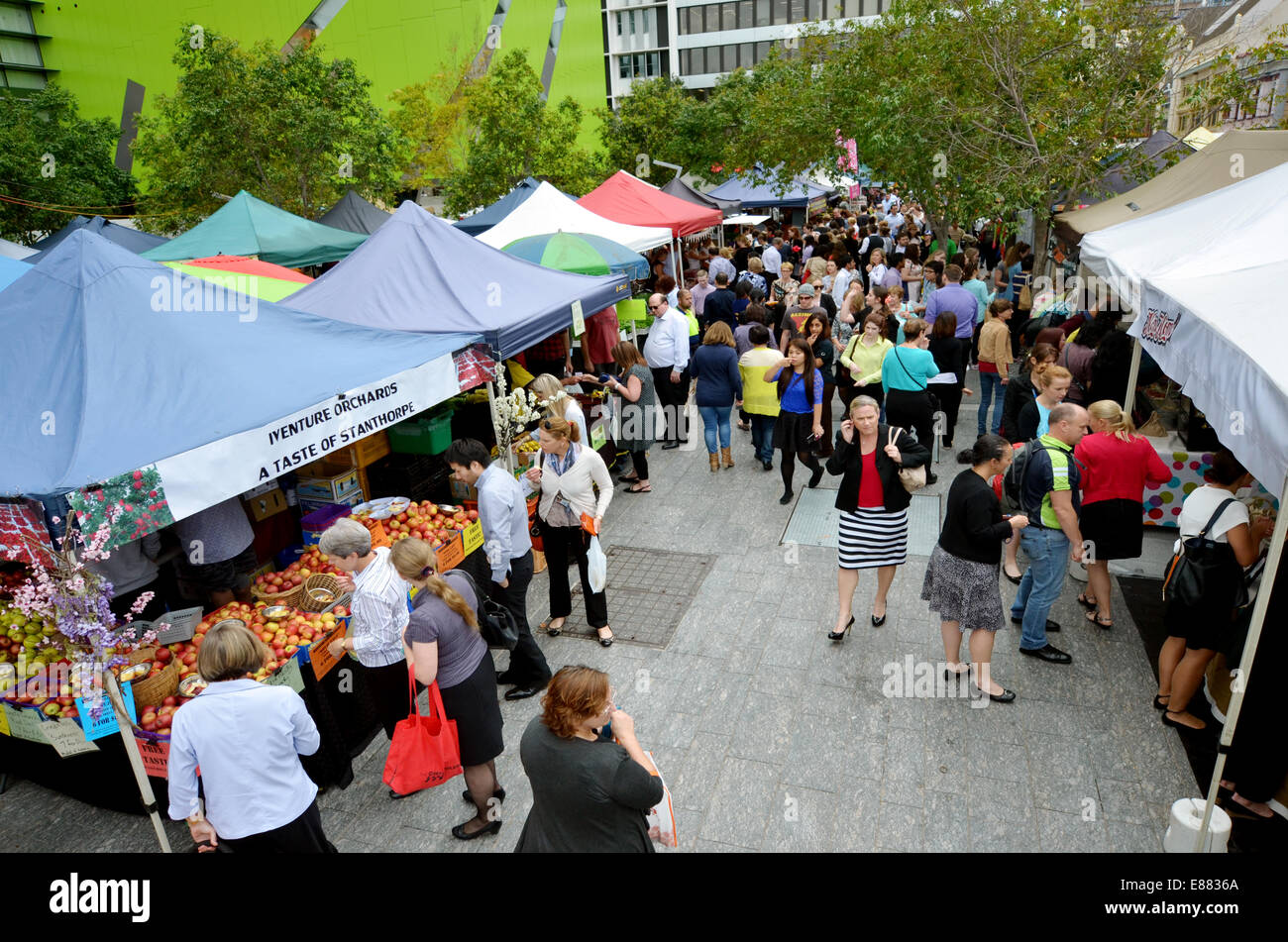 BRISBANE, AUS - SEP 25 2014:People shopping at Jan Powers Farmers Market in Brisbane City.It provide the best produce - Stock Image