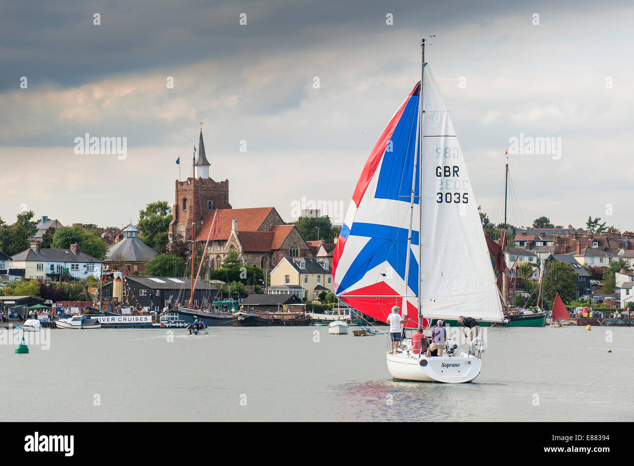A sailboat usung a colourful spinnaker as  participates in the spectacular Parade of Sail at the Maldon Regatta - Stock Image
