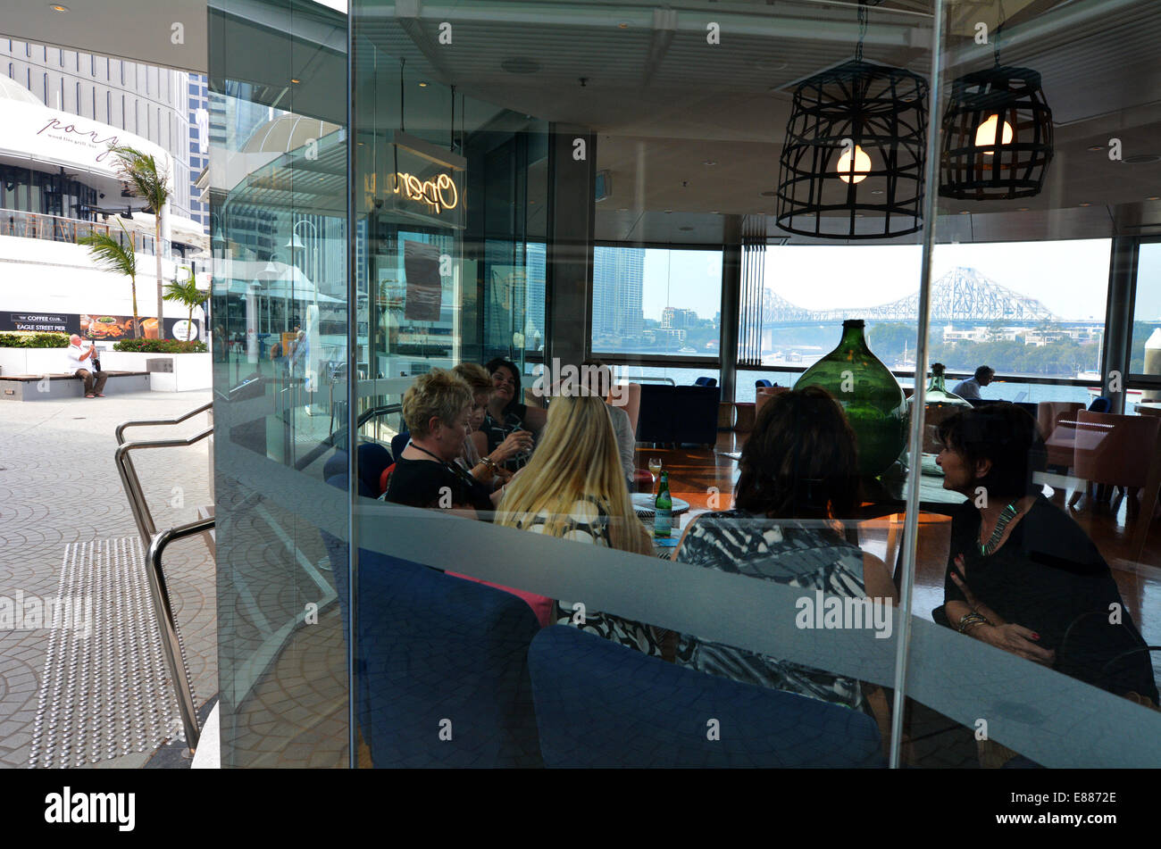 BRISBANE, AUS - SEP 25 2014:Group of women dining in restaurant at Eagle Street Pier.It is an iconic waterfront - Stock Image
