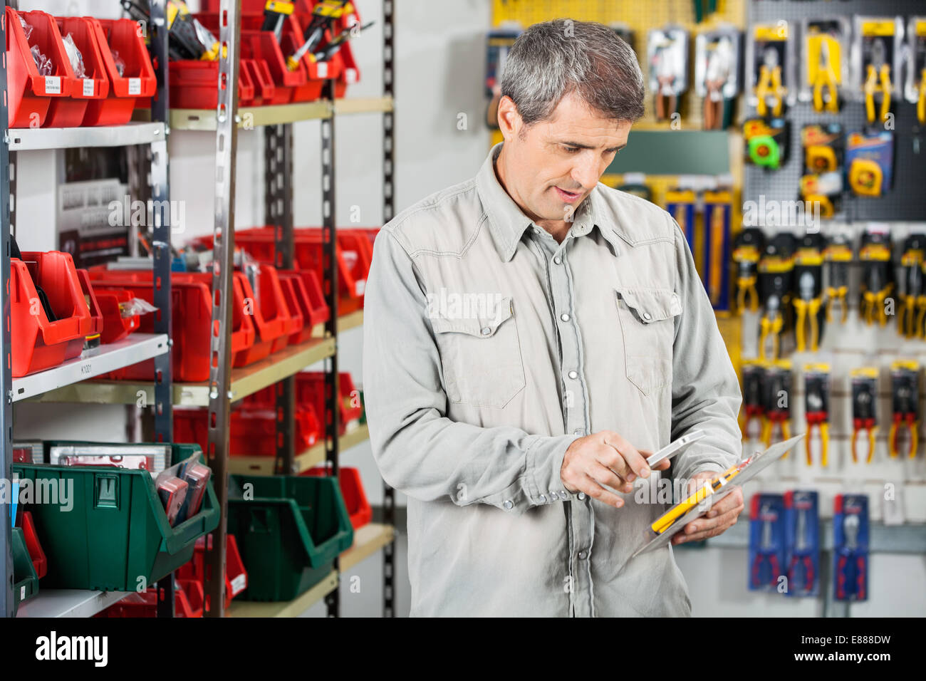 Customer Scanning Tool Packet Through Smartphone - Stock Image