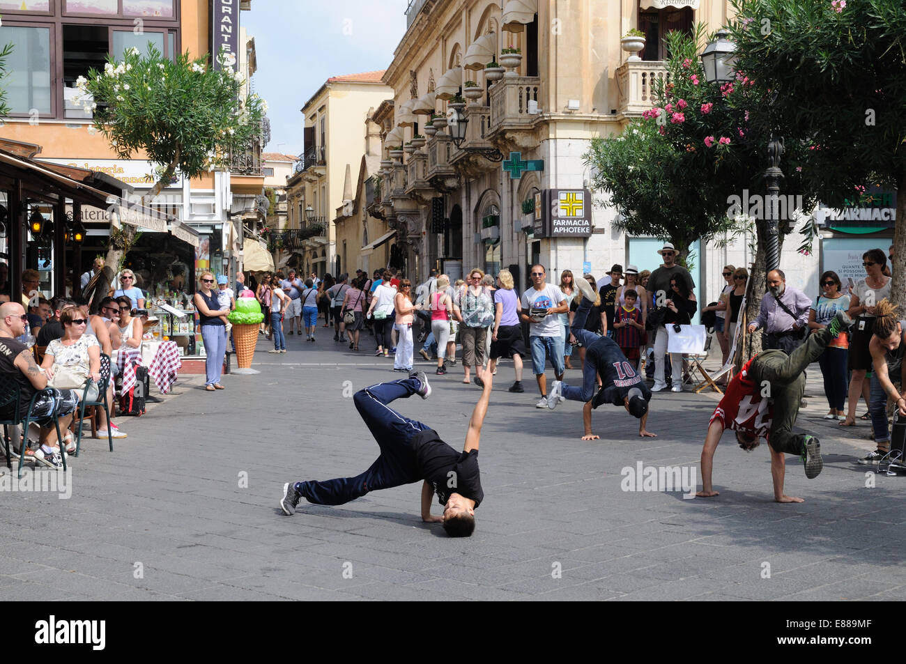Rap dancers entertaining tourists in a square  Taormina Sicily Italy - Stock Image