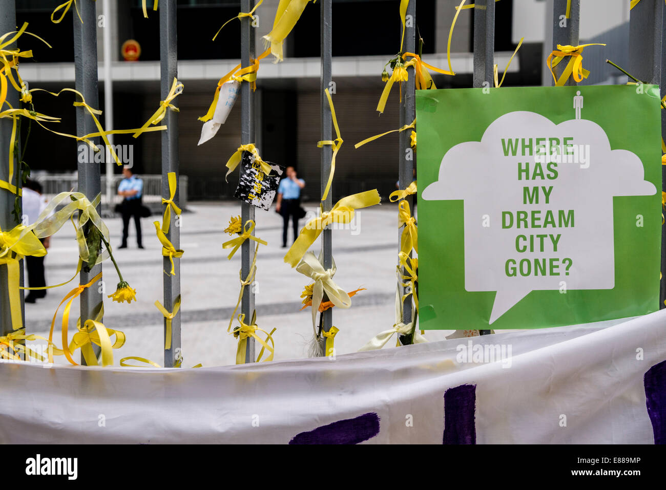 Hong Kong, China. 2nd October, 2014.  Early morning at the entrance of the HK government offices. Yellow ribbons - Stock Image