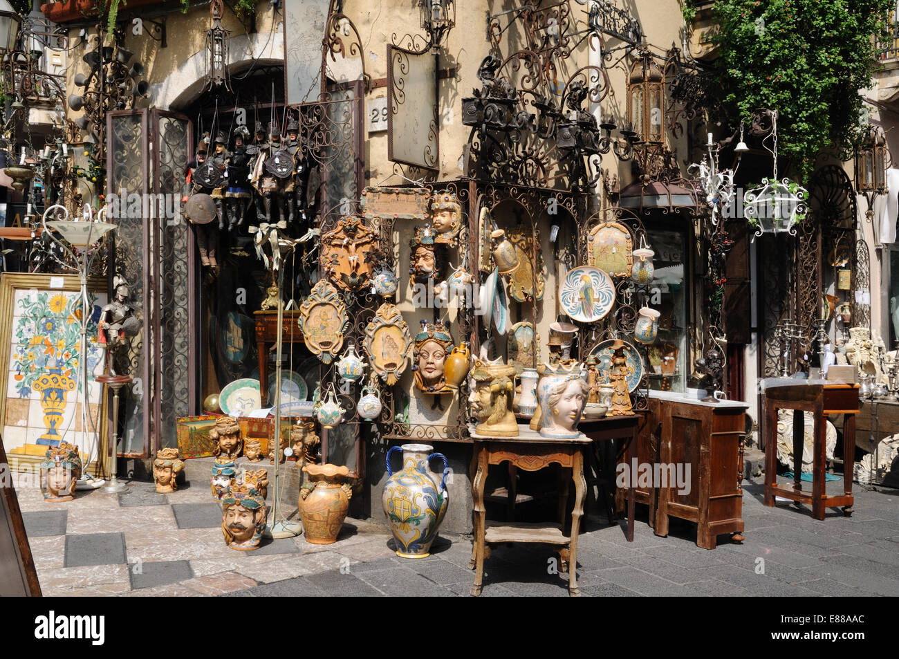Sicilian antiques for sale in a street at Taotmina Sicily Italy ...