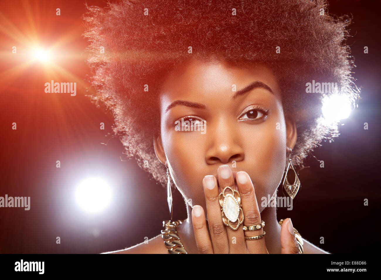 Beautiful young African woman with afro hairstyle - Stock Image