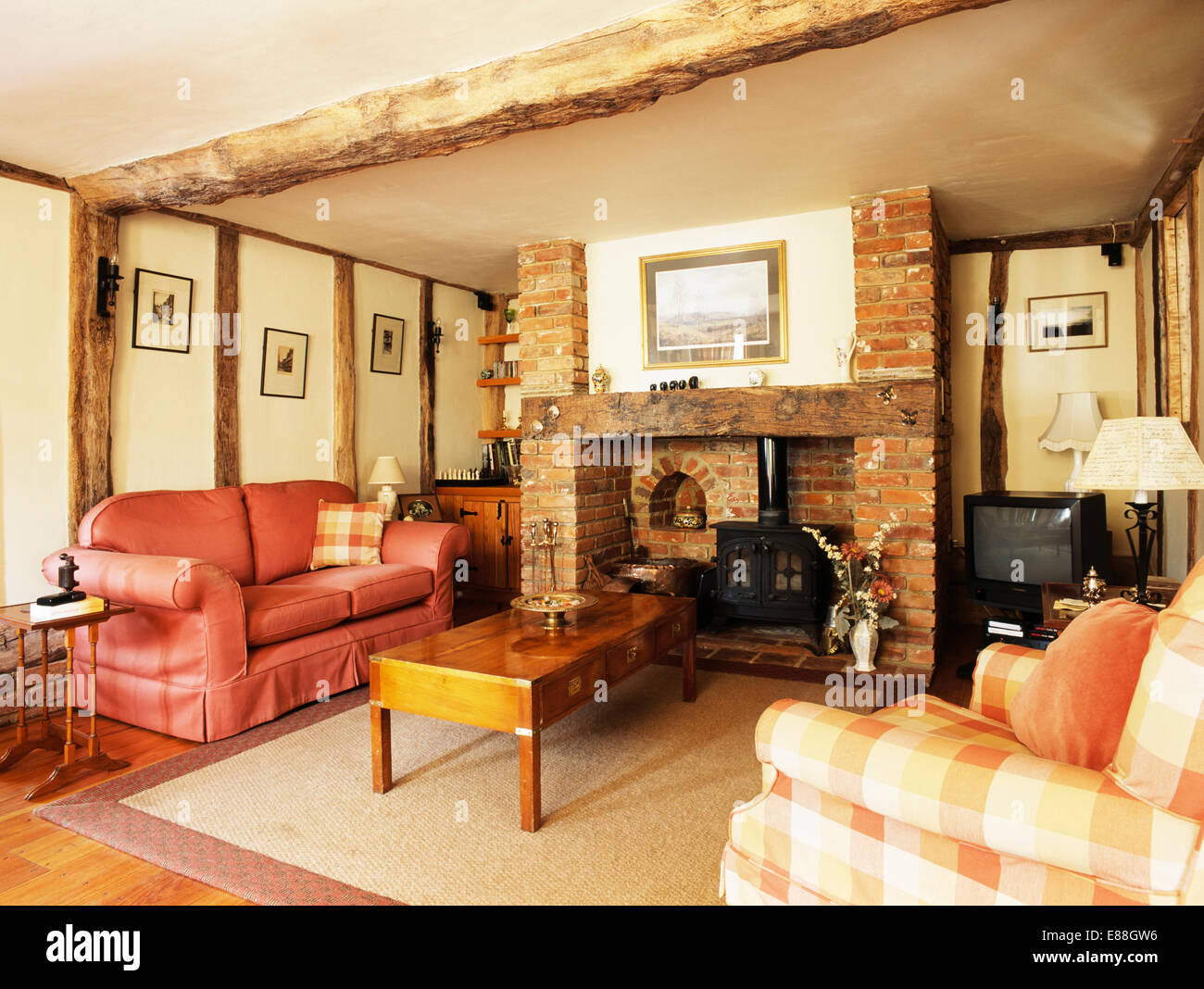 Peach Sofa In Small Barn Conversion Living Room With Coffee Table Front Of Wood Burning Stove Brick Fireplace