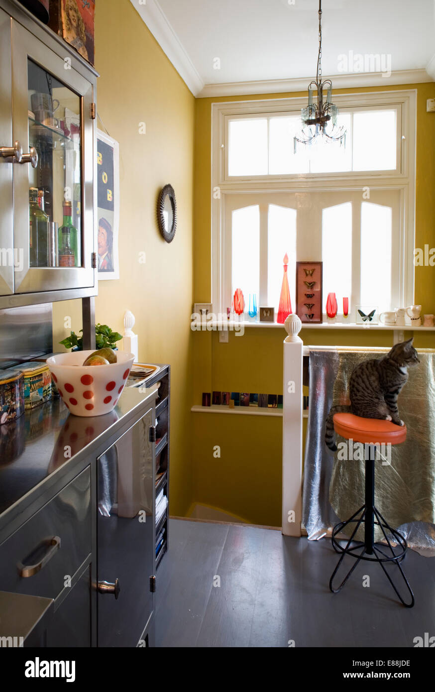 Fabulous Cat On Red Stool In Yellow Kitchen With Slate Flooring Stock Gmtry Best Dining Table And Chair Ideas Images Gmtryco