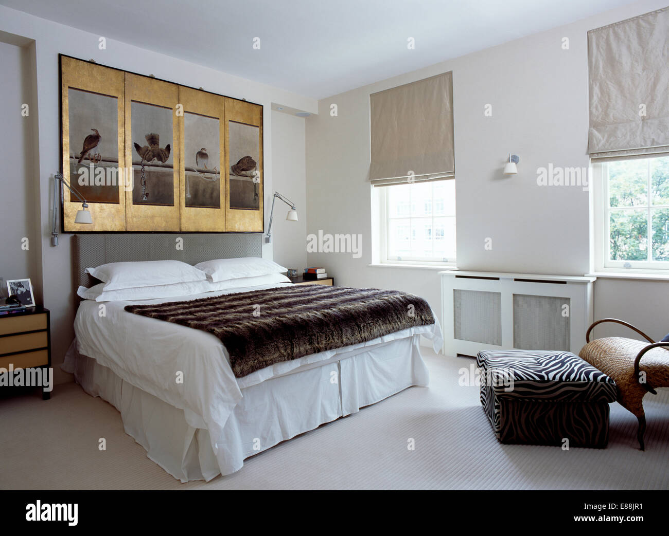 Gilt Framed Antique Panels Above Bed With Faux Fur Throw And White Linen In Modern  Bedroom With Grey Blinds At Windows
