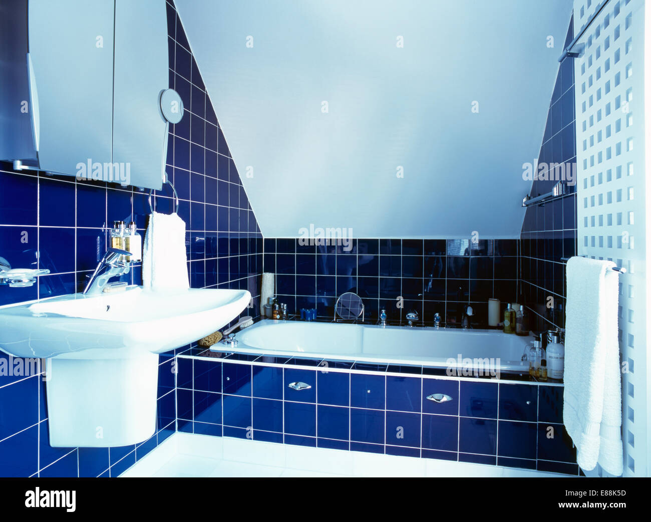 Deep blue wall tiles in modern bathroom Stock Photo: 73949385 - Alamy