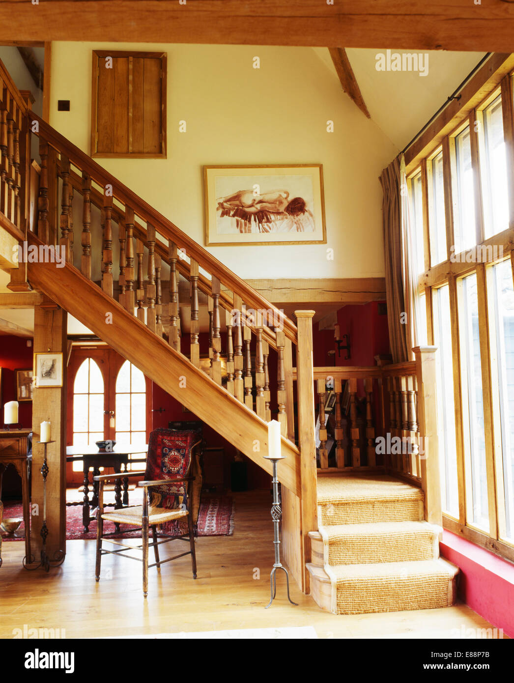 Carved Wooden Banisters On Staircase With Cream Carpet In