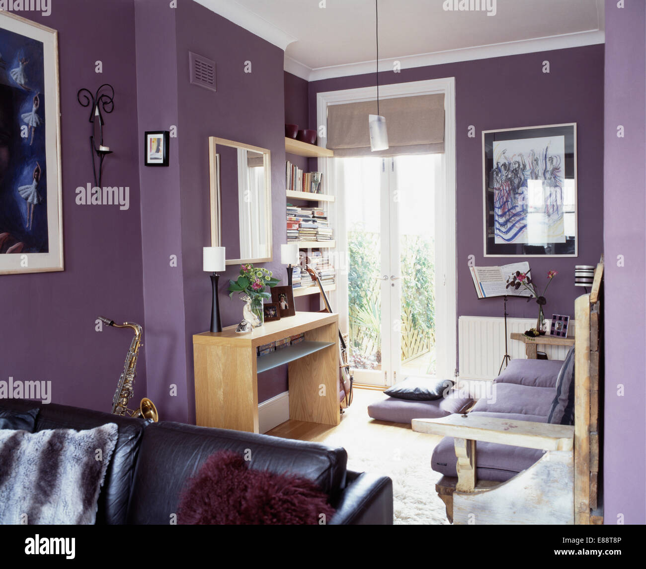 Small Wooden Desk In Modern Purple Living Room With French Windows