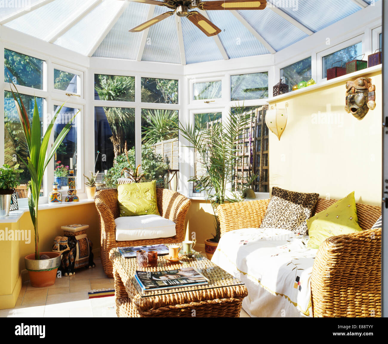 Picture of: Lime Green Cushions On Wicker Sofa And Armchair In Conservatory Stock Photo Alamy