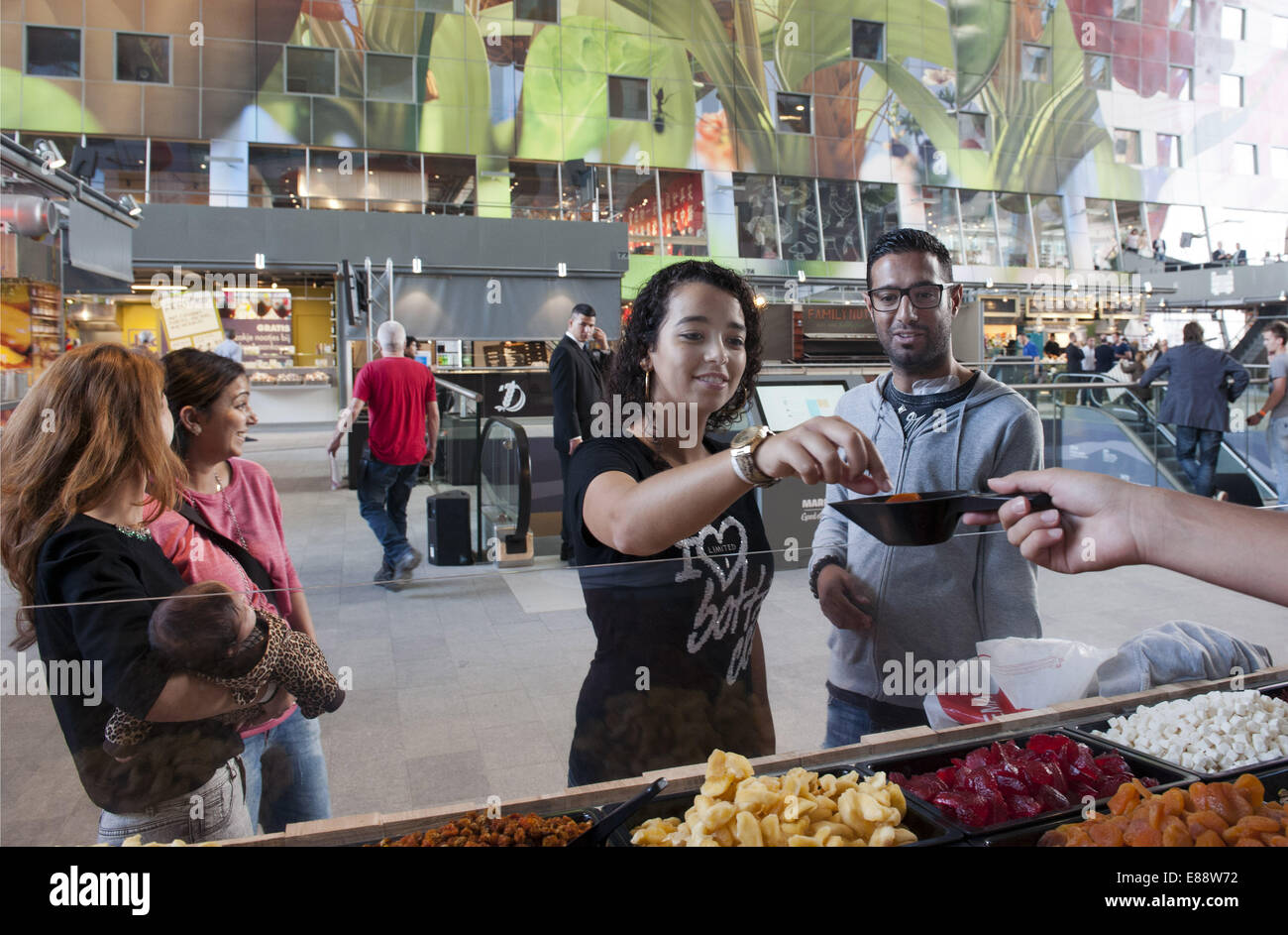 Sept. 30, 2014 - Rotterdam, South Holland, The Netherlands, Holland - Visitors of the Markthal trying sweet Turkish Stock Photo