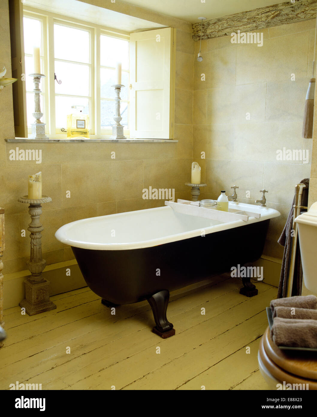 Roll Top Bath In Cottage Bathroom With Wooden Flooring And