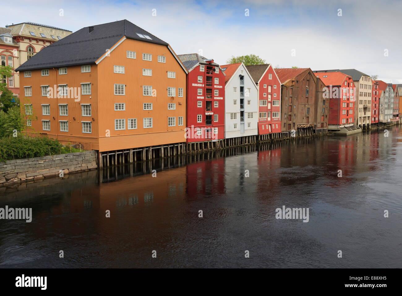 Colourful wooden warehouses on wharf beside the Nidelva River, Trondheim, Sor-Trondelag, Norway, Scandinavia, Europe - Stock Image