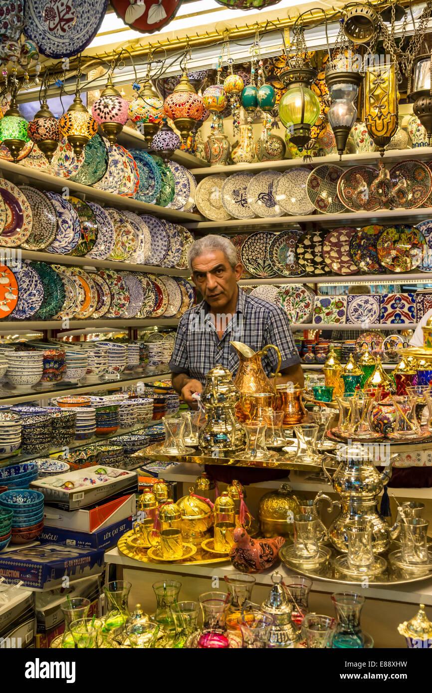 Seller (vendor) of traditional Turkish ceramics, glassware and tea sets in his shop, Grand Bazaar, Istanbul, Turkey, Europe Stock Photo