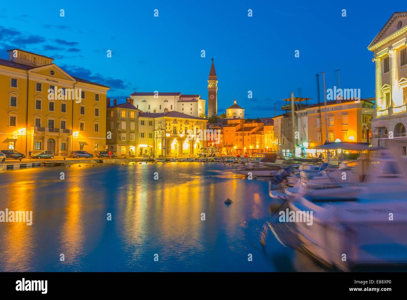 Old Town Harbour, Church of St. George (Cerkev sv. Jurija) in background, Piran, Primorska, Slovenian Istria, Slovenia, - Stock Image