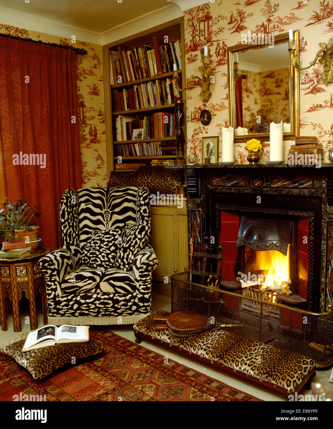 Charmant Tiger Print Wing Chair And Leopard Print Stool Beside Fireplace In Living  Room With Toile De Jouy Wallpaper